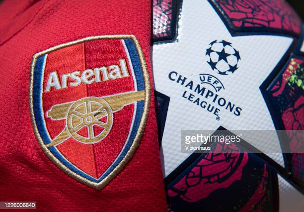 The Arsenal club crest on their first team home shirt with the official adidas UEFA Champions League Match Ball on May 14 2020 in Manchester England