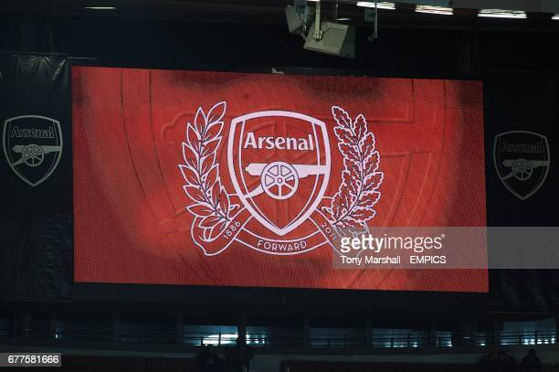 The Arsenal crest is displayed on the video screen at the Emirates Stadium before the game
