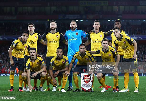 The Arsenal FC players line up before the UEFA Champions League group A match between Arsenal FC and FC Basel 1893 at the Emirates Stadium on...