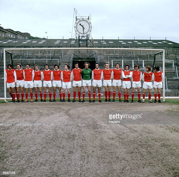 The Arsenal Football Club F A Cup Final squad stand in front of the goal at the clock end of their Highbury Stadium, London. From left to right Peter...