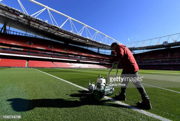 The Arsenal groundsman marks out the pitch before the Carabao Cup Third Round match between Arsenal and Brentford at Emirates Stadium on September 26...