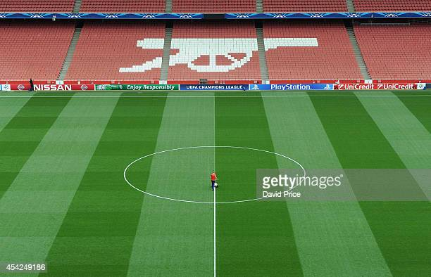 The Arsenal Groundstaff mark out the Emirates pitch before the UEFA Champions League Qualifing match between Arsenal and Besiktas at Emirates Stadium...