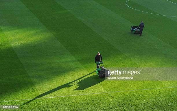 The Arsenal groundstaff prepare the Emirates Stadium pitch before the match on November 26, 2013 in London, England.
