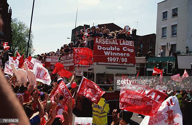 The Arsenal Ladies team taking part in an open top bus parade through the streets of Highbury to celebrate their victory in the League and FA Cup...