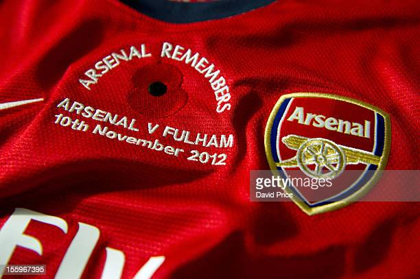The Arsenal match shirt displays a poppy to mark Remembrance Sunday before the Barclays Premier League match between Arsenal and Fulham at Emirates...