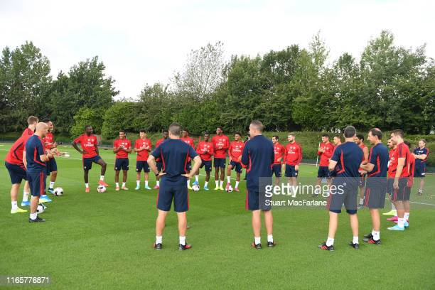 The Arsenal players and staff welcome new signing Nicolas Pepe before a training session at London Colney on August 02 2019 in St Albans England
