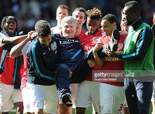 The Arsenal players carry assistant manager Pat Rice after the Barclays Premier League match between West Bromwich Albion and Arsenal at The...
