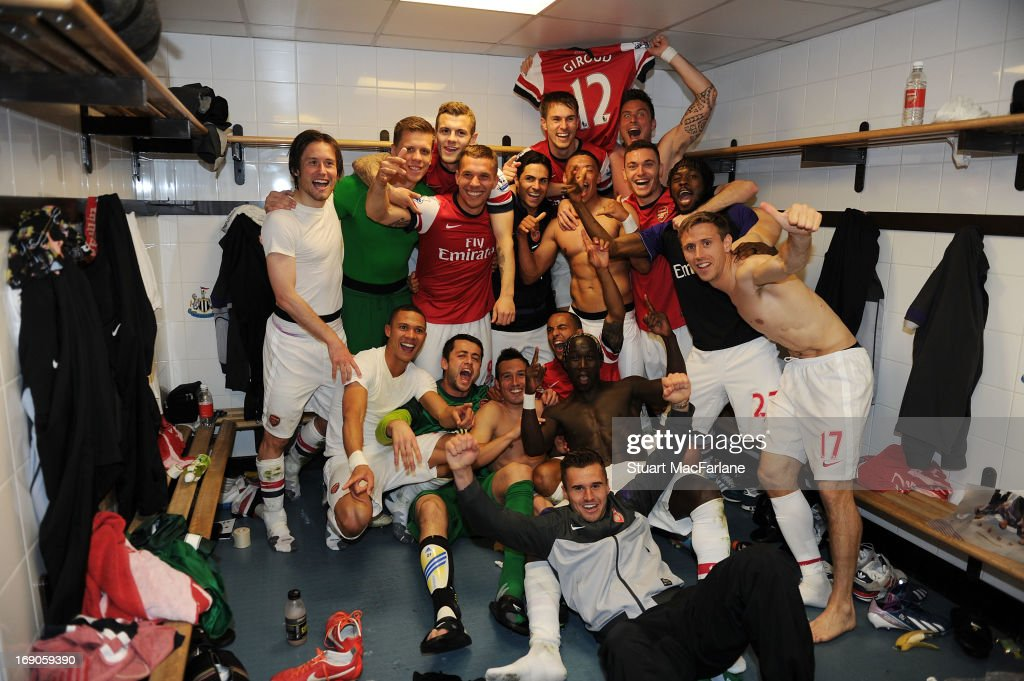 The Arsenal players celebrate in the changing room after the Barclays Premier League match between Newcastle United and Arsenal at St James' Park on May 19, 2013 in Newcastle upon Tyne, England.