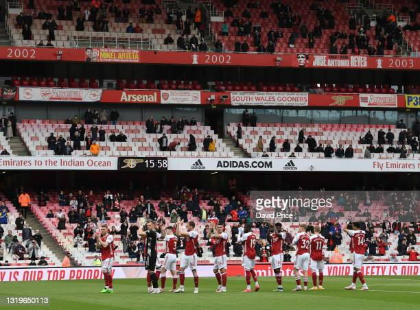 The Arsenal players clap the fans before the Premier League match between Arsenal and Brighton & Hove Albion at Emirates Stadium on May 23, 2021 in...