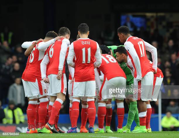 The Arsenal players in a huddle before the Premier League match between Chelsea and Arsenal at Stamford Bridge on February 4 2017 in London England