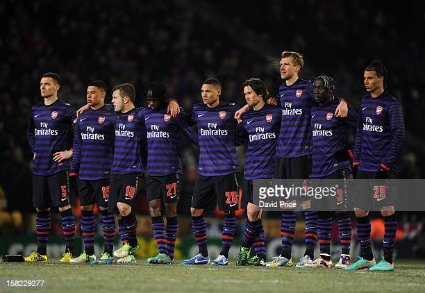 The Arsenal players link up during the penalty shoot out during the Capital One Cup match between Arsenal and Bradford City at Coral Windows Stadium...