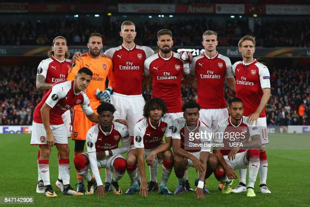 The Arsenal players pose for a team photograph prior to the UEFA Europa League group H match between Arsenal FC and FC Koln at Emirates Stadium on...