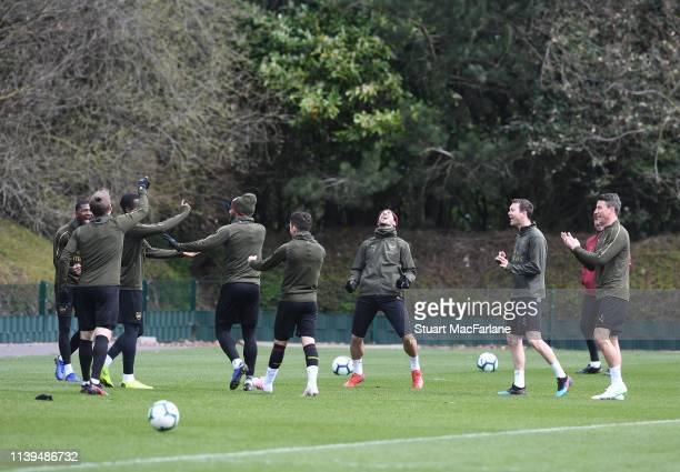The Arsenal players warm up before a training session at London Colney on March 30 2019 in St Albans England