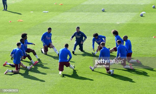 The Arsenal players warm up before the Premier League match between Leicester City and Arsenal at The King Power Stadium on February 28, 2021 in...