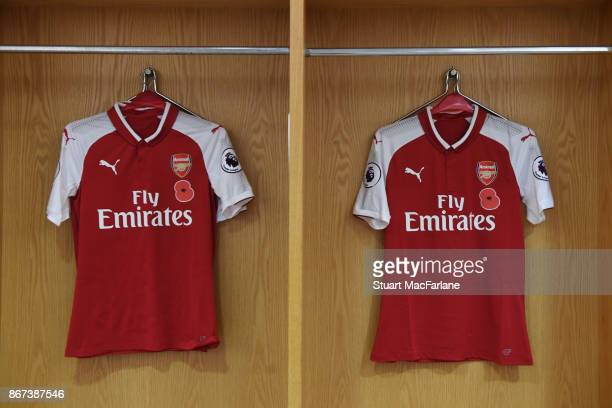 The Arsenal shirt with rememberance poppy motifs hang in the home changing room before the Premier League match between Arsenal and Swansea City at...