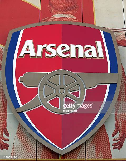 The Arsenal soccer club badge is displayed outside the Emirates stadium in London UK on Tuesday April 12 2011 Stan Kroenke the owner of National...