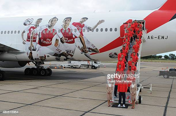 The Arsenal squad board the plane as they travel to Singapore for the Barclays Asia Trophy at Stansted Airport on July 12 2015 in London England