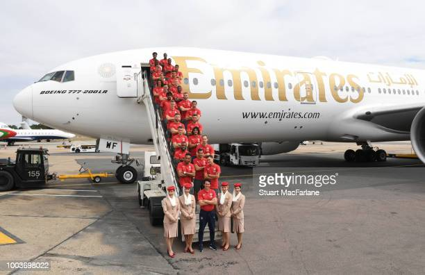 The Arsenal squad pose as they board the team flight before departing for the preseason tour of Singapore at Stansted Airport on July 22 2018 in...