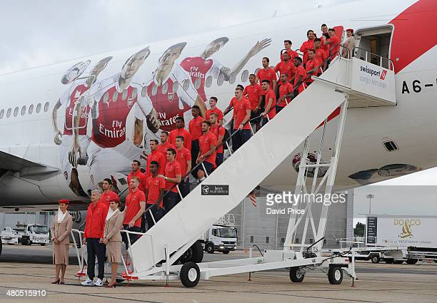 The Arsenal squad pose for a picture before boarding their Emirates plane at Stansted Airport on July 12 2015 in London England