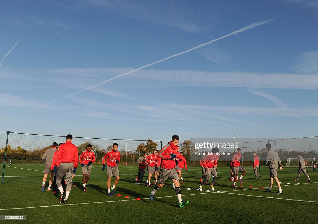 The Arsenal squad warm up before a training session in preparation for the Premier League match against AFC Bournemouth at London Colney on November 26, 2016 in St Albans, England.