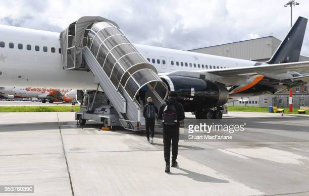 The Arsenal team board the team flight to Madrid at Luton Airport on May 2 2018 in Luton England