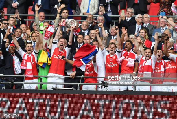 The Arsenal team celebrate after winning the Emirates FA Cup Final between Arsenal and Chelsea at Wembley Stadium on May 27 2017 in London England