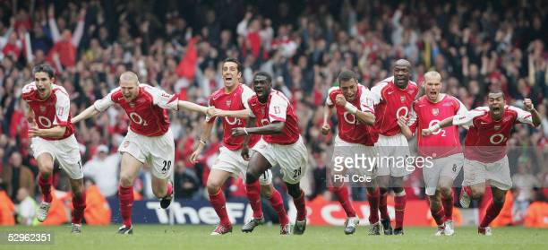 The Arsenal team celebrate Patrick Vieira scoring the last penalty to win the FA Cup Final between Arsenal and Manchester United 54 at The Millennium...