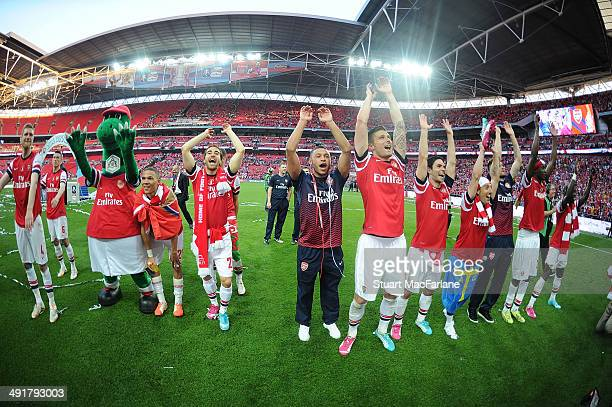 The Arsenal team celebrate winning the FA Cup Final between Arsenal and Hull City at Wembley Stadium on May 17 2014 in London England
