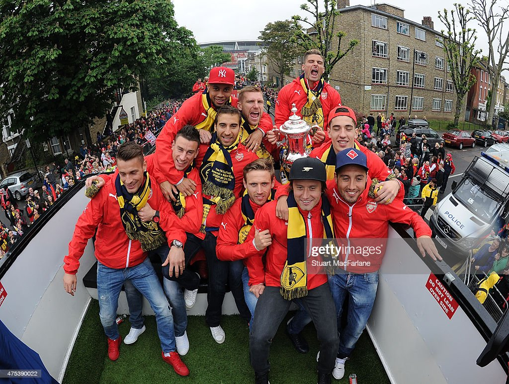 The Arsenal team celebrate with the cup during the FA Cup Victory Parade in Islington on May 31, 2015 in London, England.