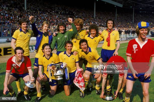 The Arsenal team celebrate with the FA Cup back row lr Steve Walford David Price Pat Jennings Willie Young Alan Sunderland David O'Leary front row lr...