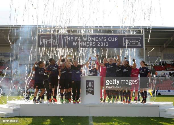 The Arsenal team celebrate with the FA Cup during The FA Women's Cup Final match betweenArsenal and Bristol Academy at Keepmoat Stadium on May 26...