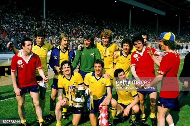The Arsenal team celebrate with the FA Cup Steve Walford David Price Pat Jennings Willie Young Alan Sunderland David O'Leary Liam Brady Pat Rice...