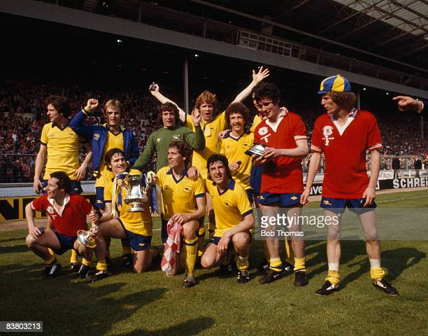The Arsenal team celebrate with the trophy after defeating Manchester United 32 in the FA Cup Final at Wembley Stadium 12th May 1979 Back row Steve...