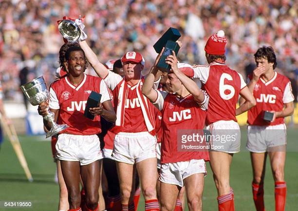 The Arsenal team celebrate with the trophy after the Littlewoods League Cup Final between Arsenal and Liverpool at Wembley Stadium in London 5th...