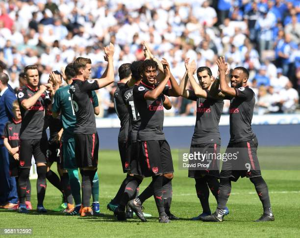 The Arsenal team claps the fans before the Premier League match between Huddersfield Town and Arsenal at John Smith's Stadium on May 13 2018 in...