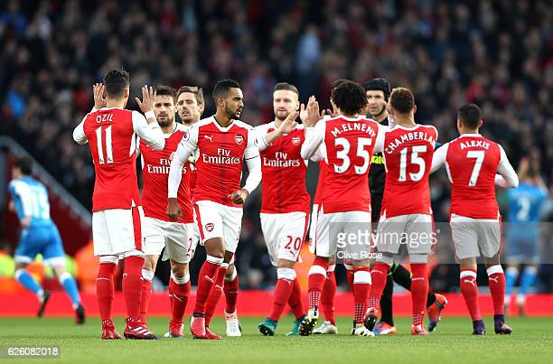 The Arsenal team embrace prior to kick off during the Premier League match between Arsenal and AFC Bournemouth at Emirates Stadium on November 27...