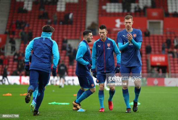 The Arsenal team including Per Mertesacker and Laurent Koscielny warm up during the Premier League match between Southampton and Arsenal at St Mary's...