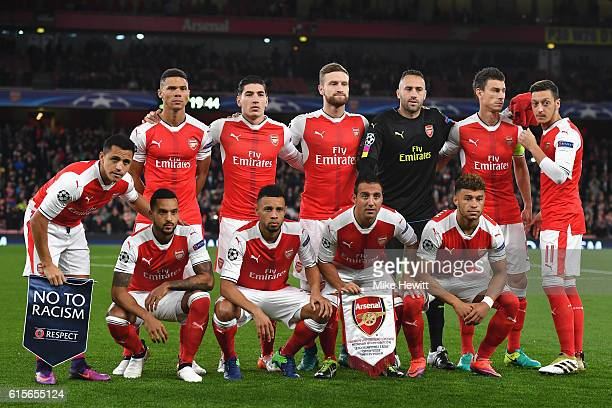 The Arsenal team line up ahead of the UEFA Champions League group A match between Arsenal FC and PFC Ludogorets Razgrad at the Emirates Stadium on...