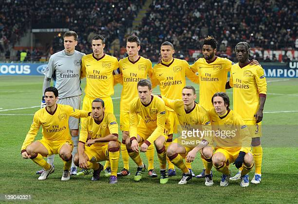 The Arsenal team line up before the UEFA Champions League Round of 16 match between AC Milan and Arsenal FC at San Siro Stadium on February 15 2012...