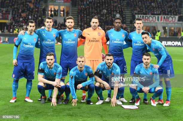 The Arsenal team line up before the UEFA Europa League Round of 16 match between AC Milan and Arsenal at the San Siro on March 8 2018 in Milan Italy
