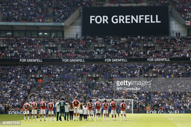 TOPSHOT The Arsenal team lines up during a minute of silence for the victims of the Grenfell disaster before the start of the English FA Community...