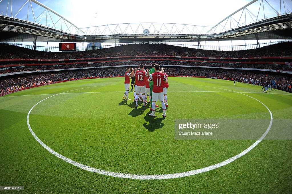 The Arsenal team lune up before the Barclays Premier League match between Arsenal and West Bromwich Albion at Emirates Stadium on May 4, 2014 in London, England.