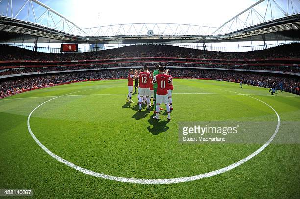 The Arsenal team lune up before the Barclays Premier League match between Arsenal and West Bromwich Albion at Emirates Stadium on May 4 2014 in...