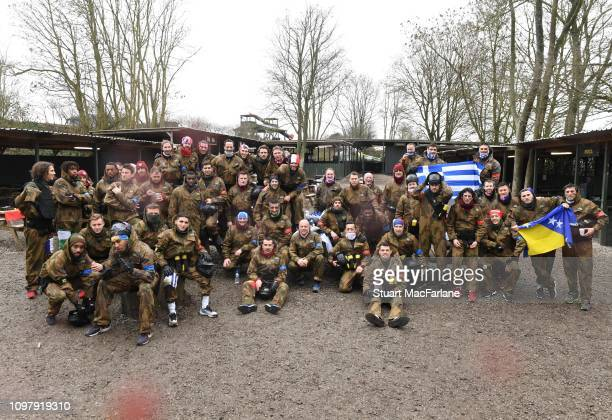 The Arsenal team pose for a group photo after taking part in a paintball session on January 21 2019 in Hemel Hempstead England
