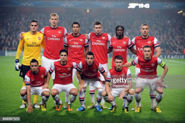 The Arsenal team pose for a group picture prior to the UEFA Champions League match between Arsenal and FC Schalke at the Emirates Stadium on October...