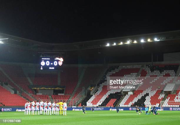 The Arsenal team 'take a knee' in front of the Slavia Prague team before the UEFA Europa League Quarter Final Second Leg match between Slavia Praha...