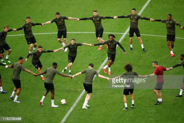 The Arsenal team train during an Arsenal training session on the eve of the UEFA Europa League Final against Chelsea at Baku Olimpiya Stadion on May...