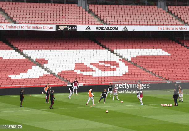 The Arsenal team warm up before a friendly match between Arsenal and Brentford at Emirates Stadium on June 10 2020 in London England