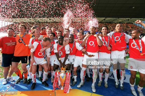 The Arsenal team with the Premier League Trophy after the Premier League match between Arsenal and Leicester City on May 15 2004 in London England