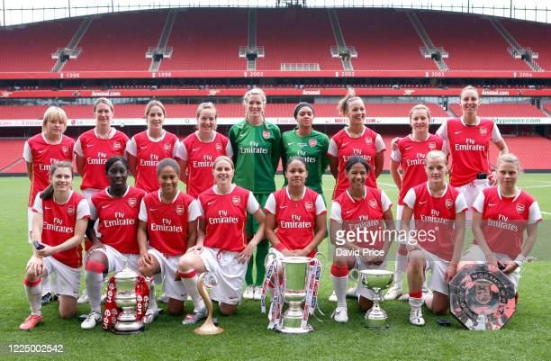 The Arsenal Womens team with the Womens FA Cup Trophy Womens UEFA Cup Trophy Womens League Cup Trophy Womens Premier League Trophy and the Womens...